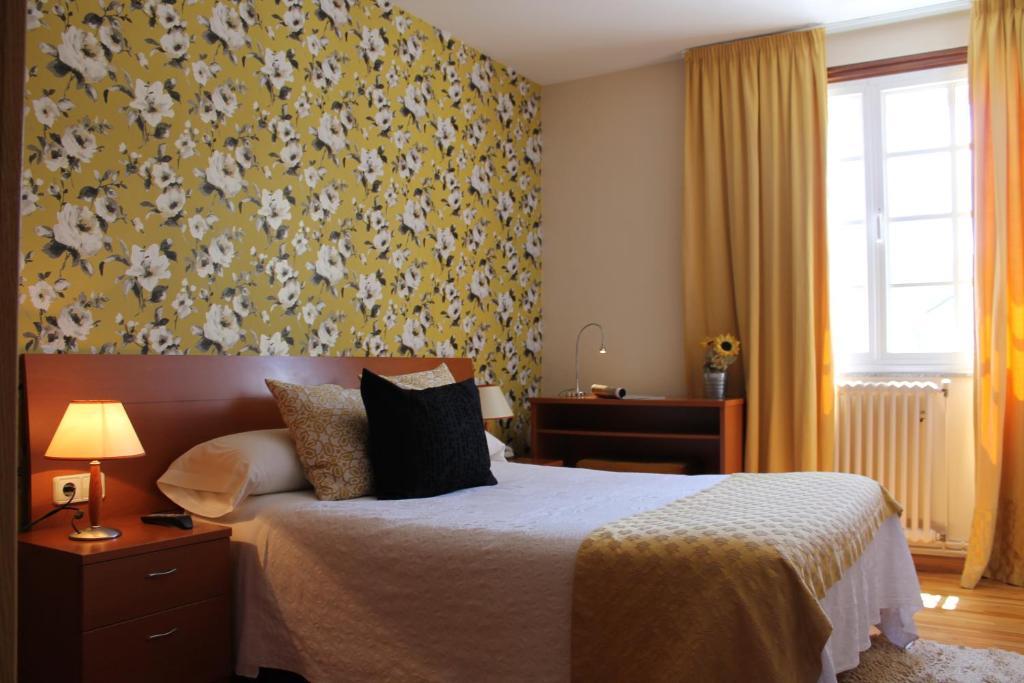 Cama o camas de una habitación en Hotel Montero