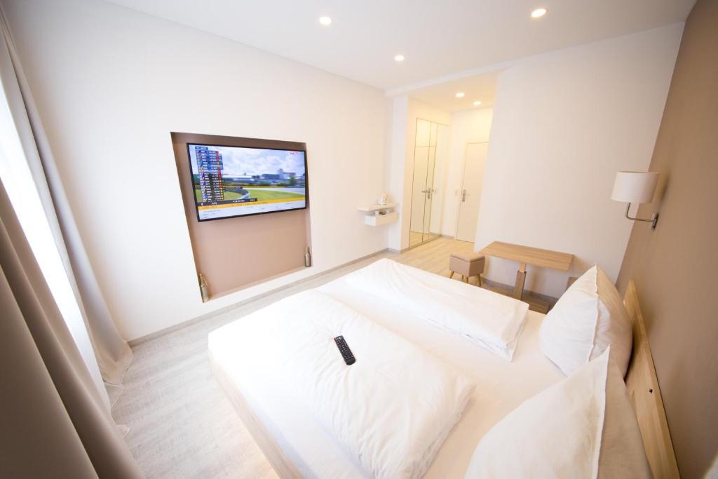 Ein Bett oder Betten in einem Zimmer der Unterkunft L-DOM