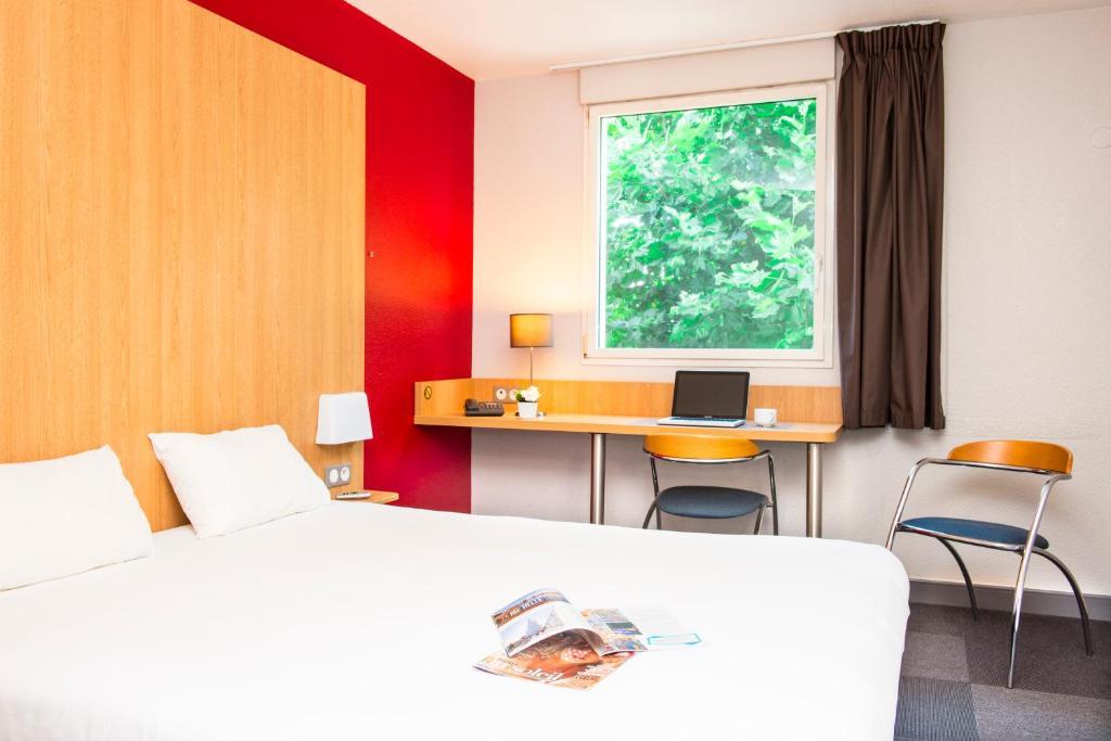 Un ou plusieurs lits dans un hébergement de l'établissement B&B La Rochelle Centre