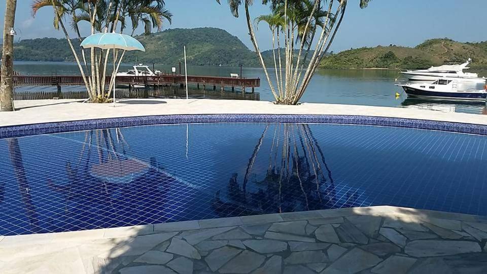 The swimming pool at or near Casa Angra Itanema