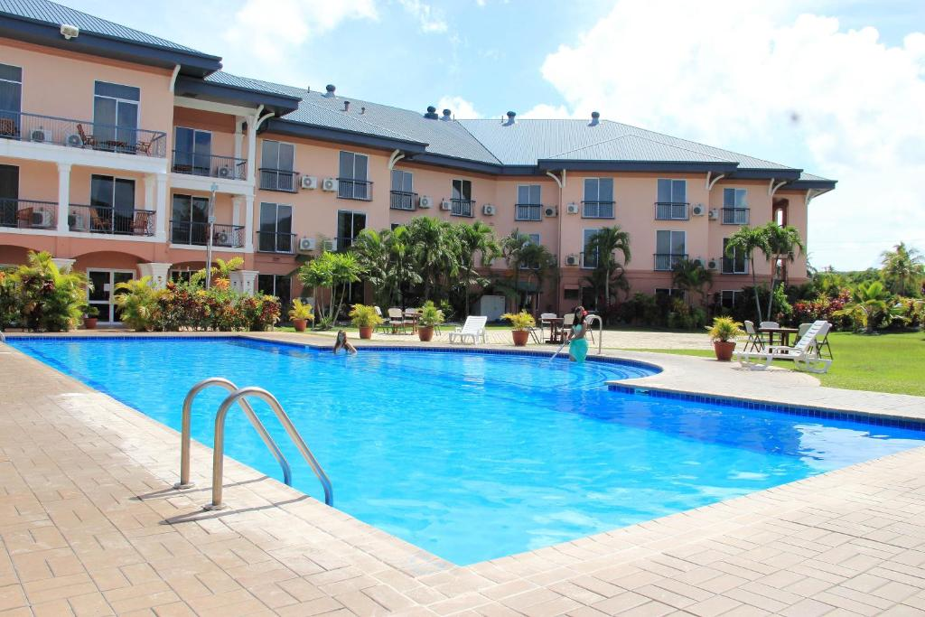 The swimming pool at or near Tradewinds Hotel