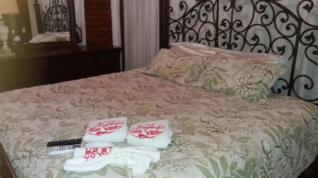A bed or beds in a room at Pousada dos Meus Sonhos