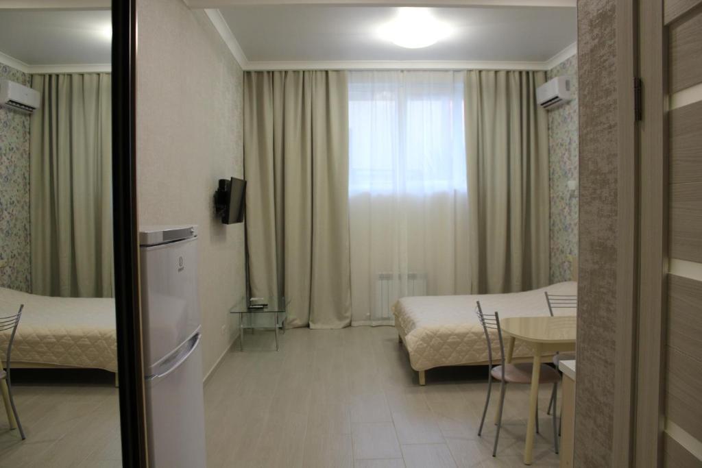 Кровать или кровати в номере Apartment on Bytkha 20/4