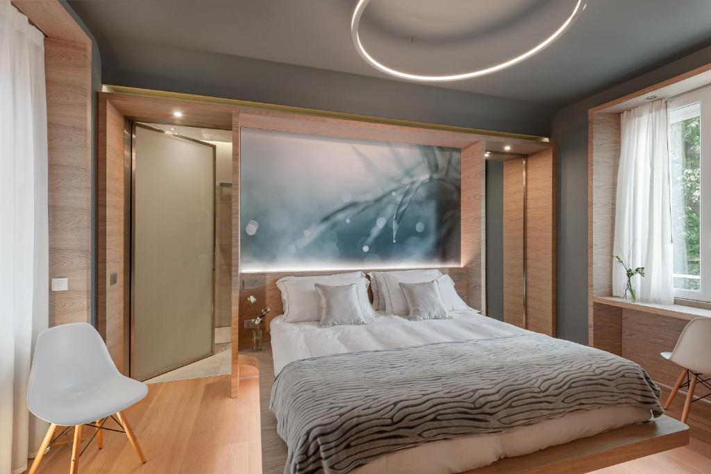 Letto o letti in una camera di Air Suite Verona