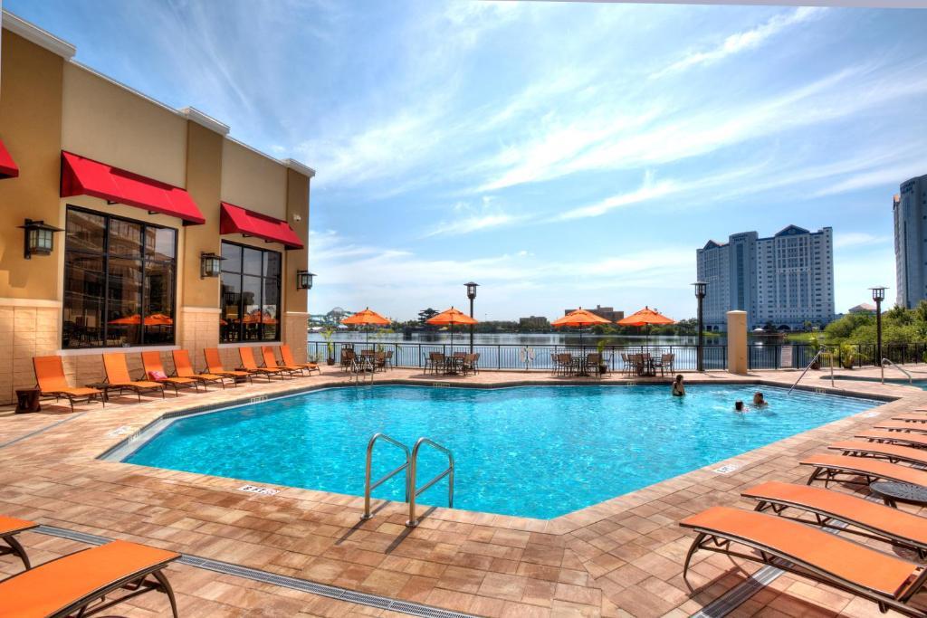 The swimming pool at or near Ramada Plaza Resort & Suites By Wyndham Orlando International Drive