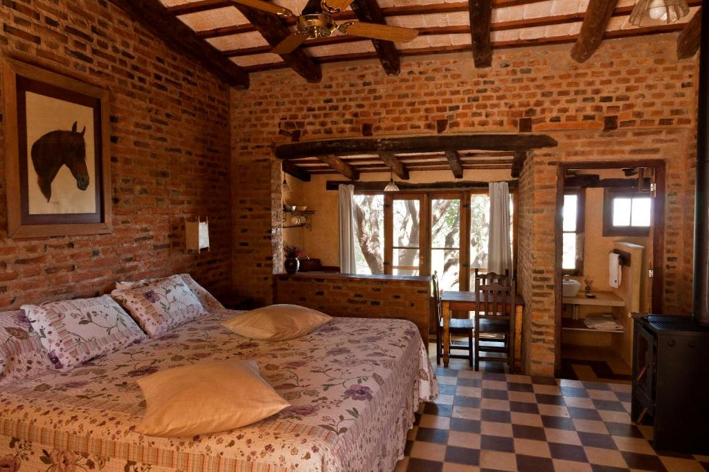 A bed or beds in a room at LAS JARILLAS Hosteria&bodega