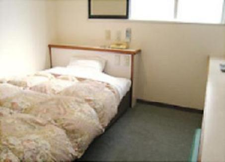 A bed or beds in a room at Matsue Plaza Hotel Annex