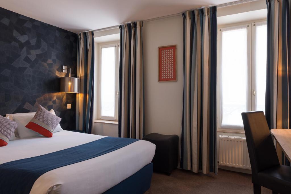 מיטה או מיטות בחדר ב-Hotel France Albion