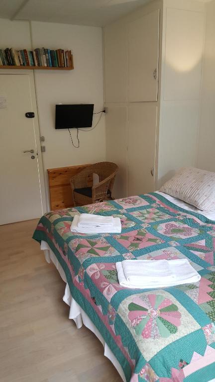 En eller flere senge i et værelse på Thorup Guesthouse