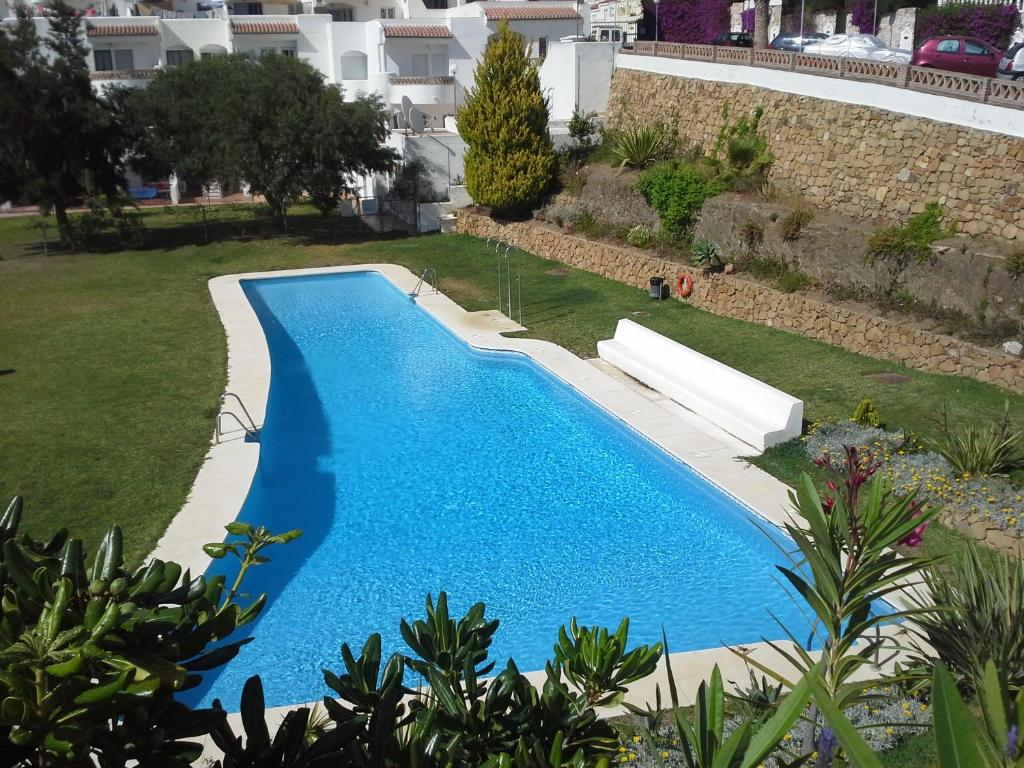 A view of the pool at Townhouse Mar y Sol or nearby