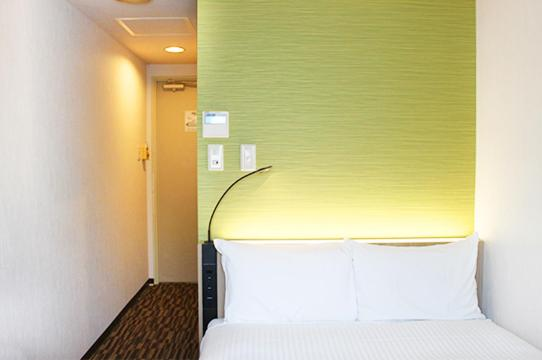 A bed or beds in a room at Smile Hotel Tokyo Asagaya