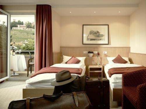 Ein Bett oder Betten in einem Zimmer der Unterkunft Edy's Hotel Restaurant im Glattfelder