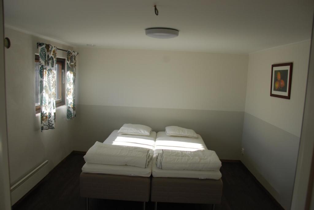 Säng eller sängar i ett rum på BOARYD B&B