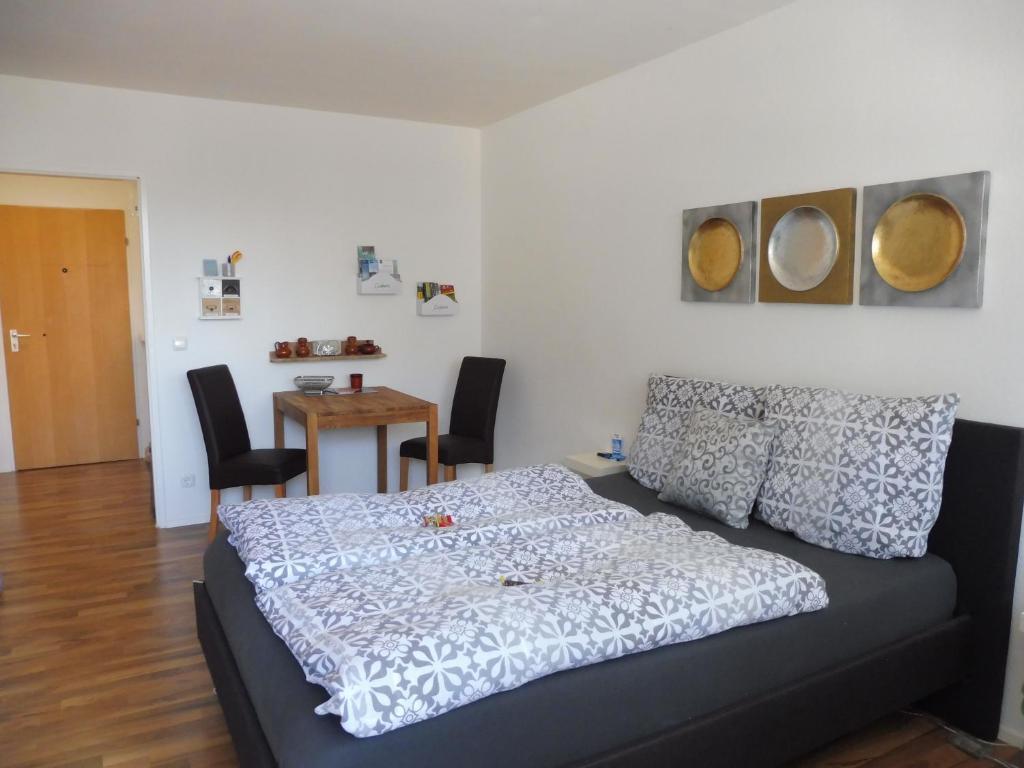 Ein Bett oder Betten in einem Zimmer der Unterkunft Schnuckelig und Fein