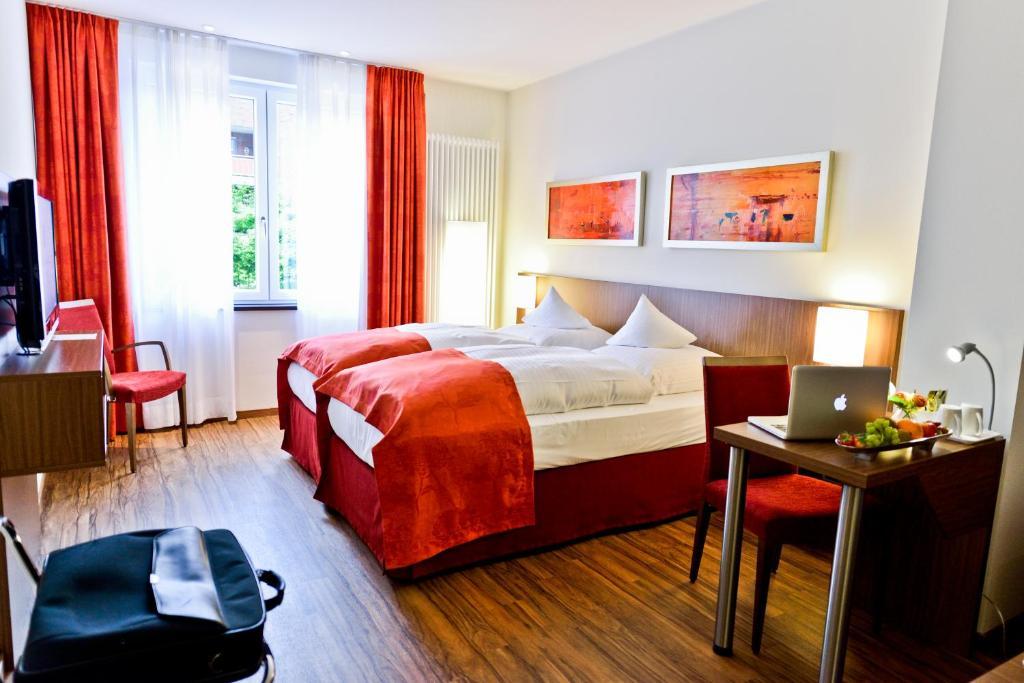 Кровать или кровати в номере Hotel Klostergarten