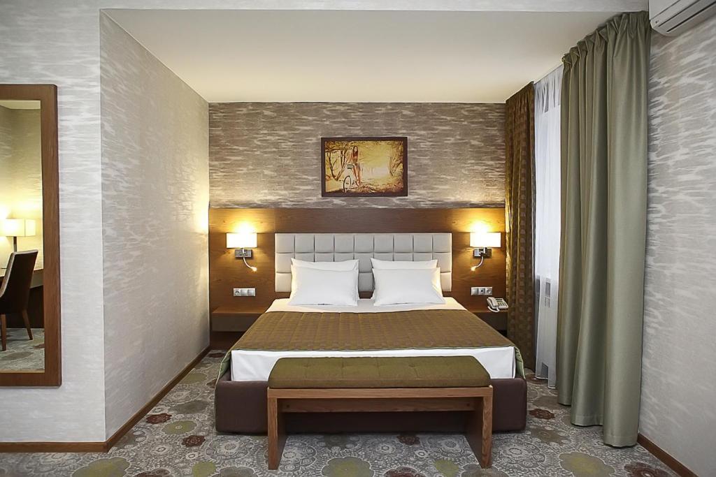 Кровать или кровати в номере Гостиница Бон Апарт