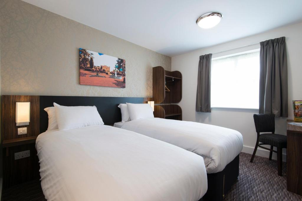 A bed or beds in a room at Kings Chamber, Doncaster by Marston's Inns