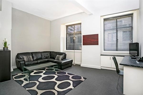 A seating area at Apartment Bridge Street 4 CLD01