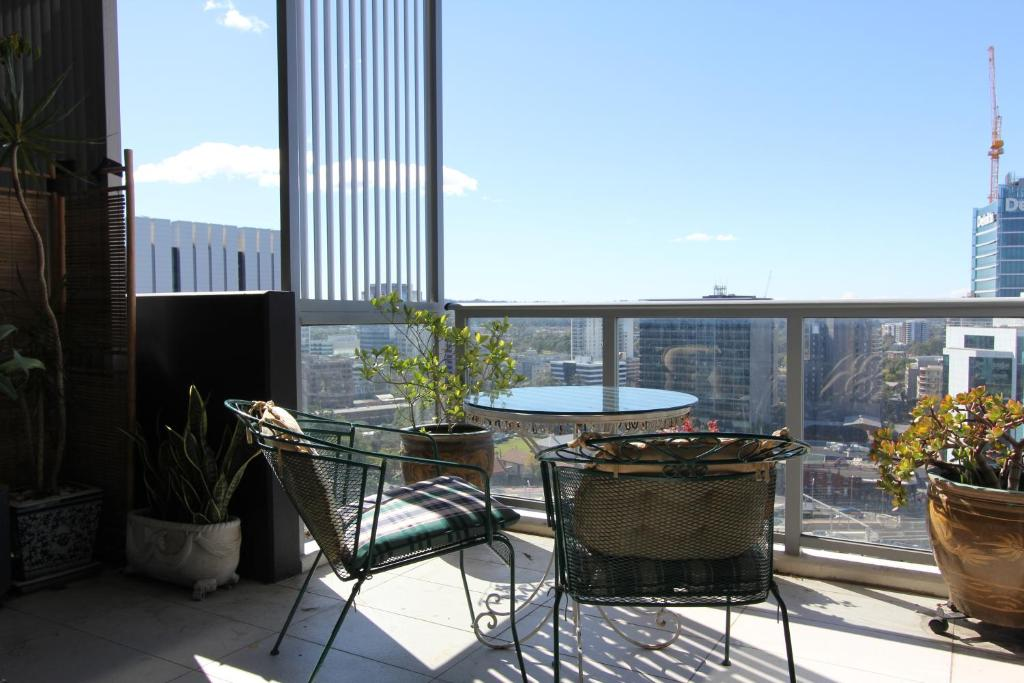 A balcony or terrace at Church St Accommodation in Parramatta CBD