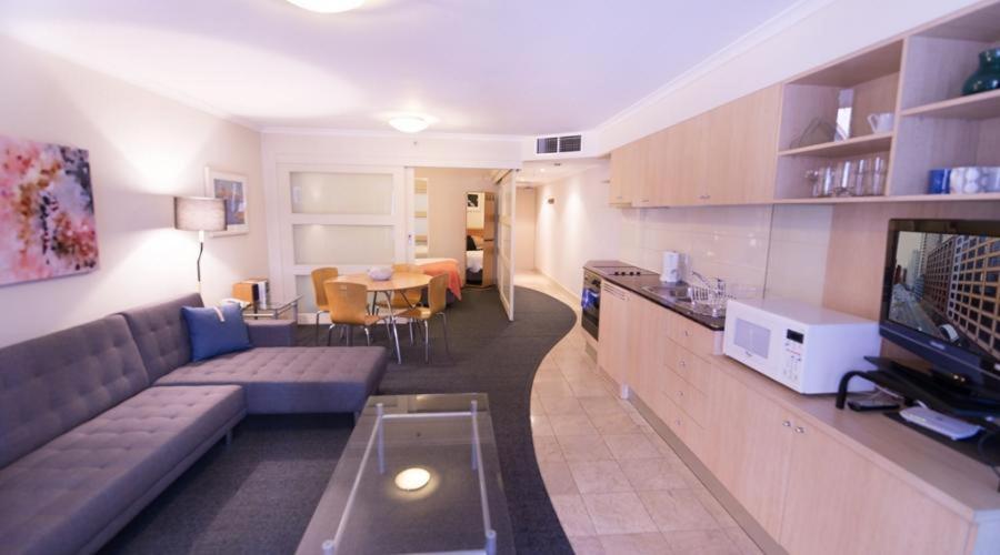 A kitchen or kitchenette at Apartment Kent street PI702