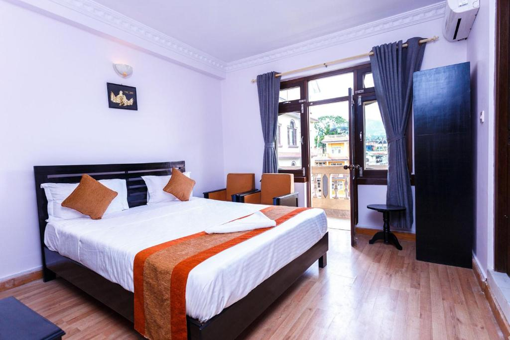 A bed or beds in a room at Alliance Hotel-Boudhanath Stupa