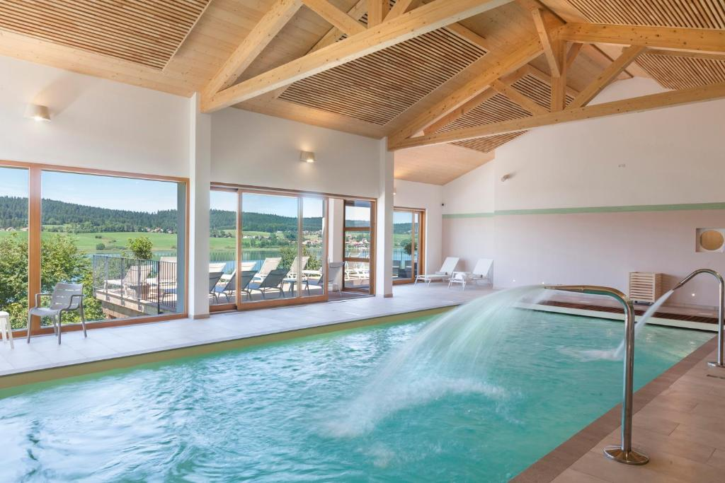 The swimming pool at or near Hotel Spa Les Rives Sauvages