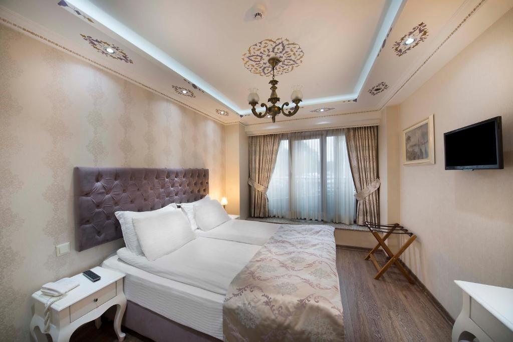 Кровать или кровати в номере World Heritage Hotel Istanbul