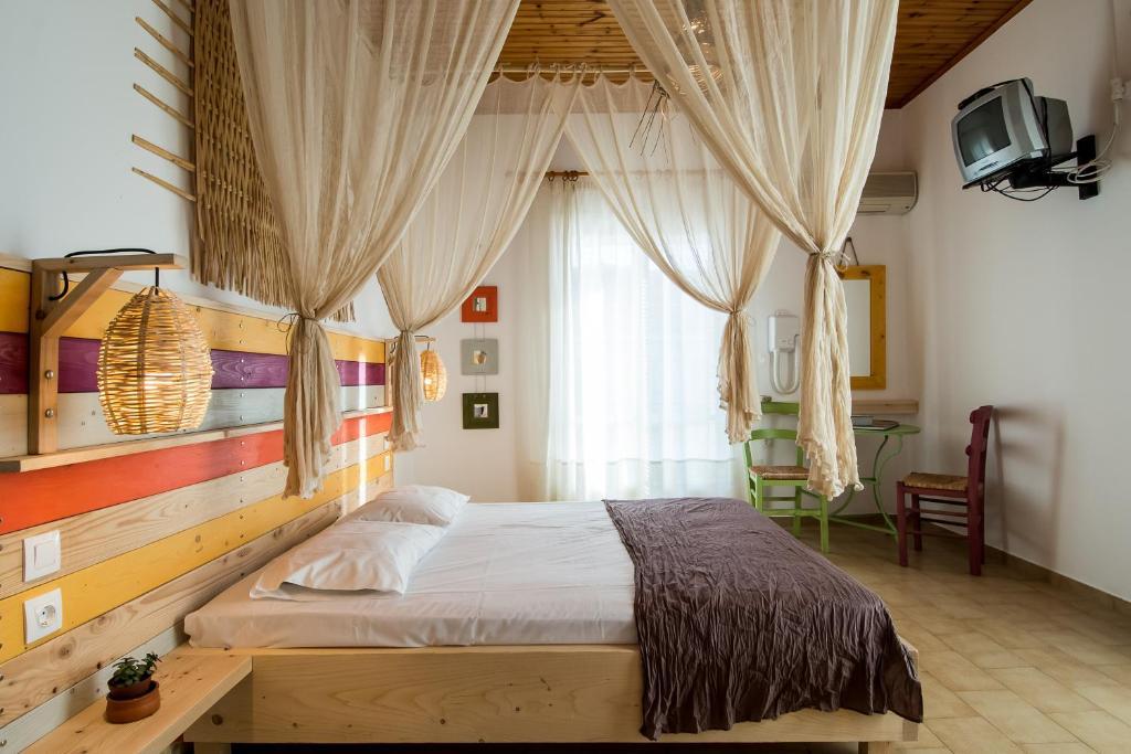 Ένα ή περισσότερα κρεβάτια σε δωμάτιο στο Kanela Studios