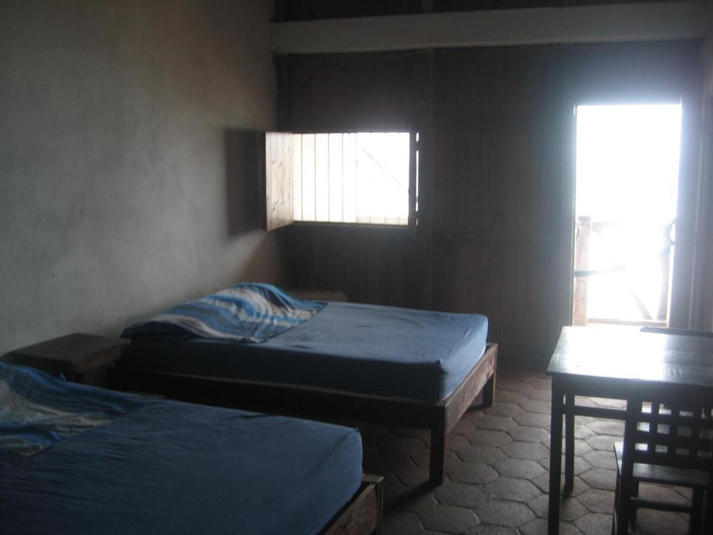 A bed or beds in a room at Posada Brisa Marina