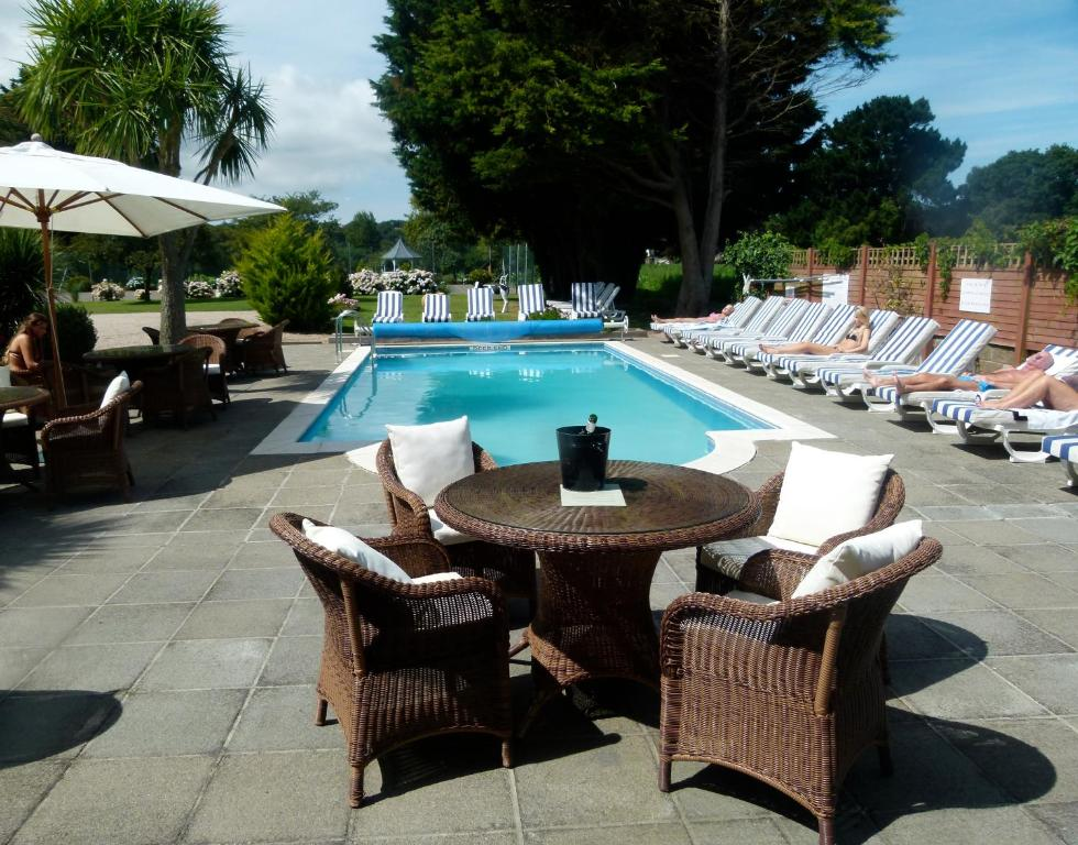 The swimming pool at or near Beachcombers Hotel