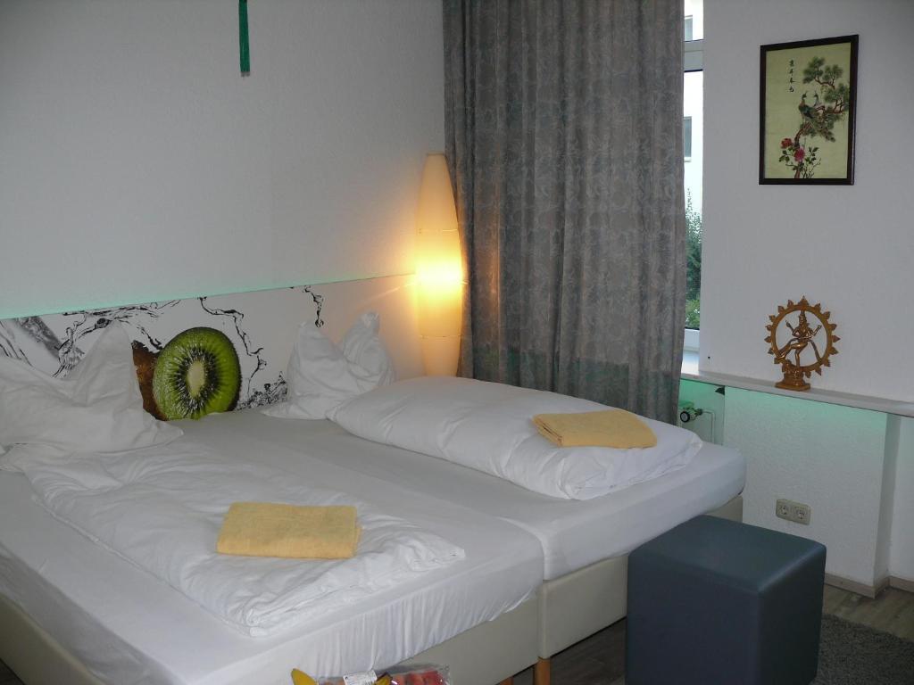Ein Bett oder Betten in einem Zimmer der Unterkunft Guest House Projade105
