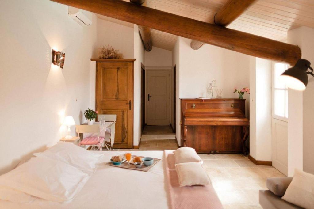 Un ou plusieurs lits dans un hébergement de l'établissement Provence Dodo