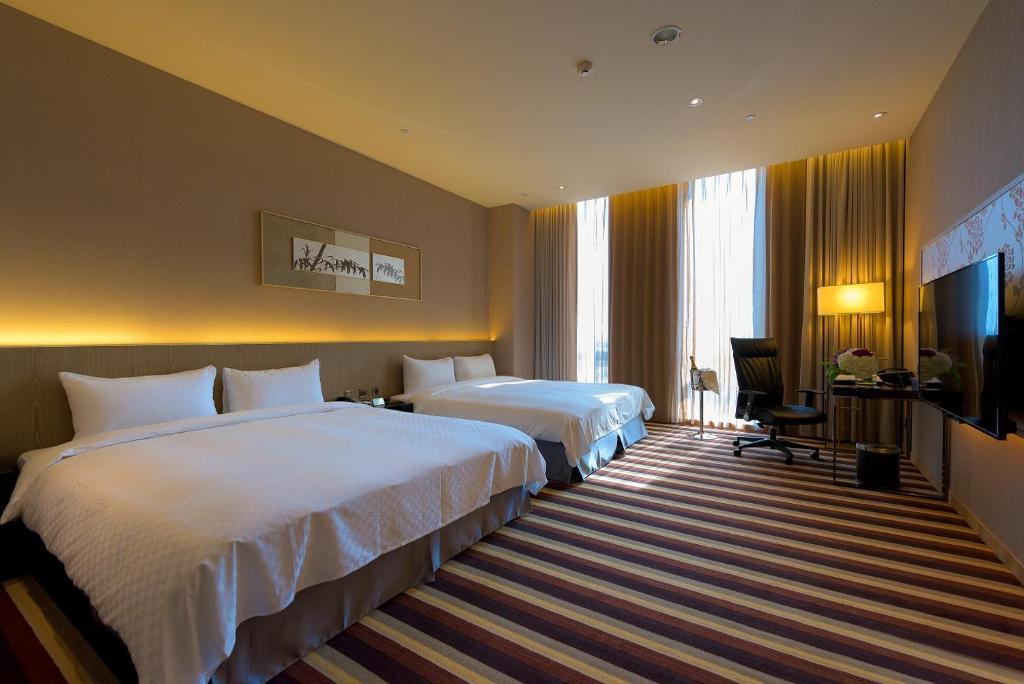 尚順君樂飯店房間的床