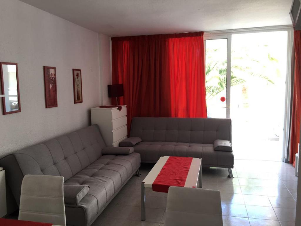 Een zitgedeelte bij Apart Hotel Ponderosa