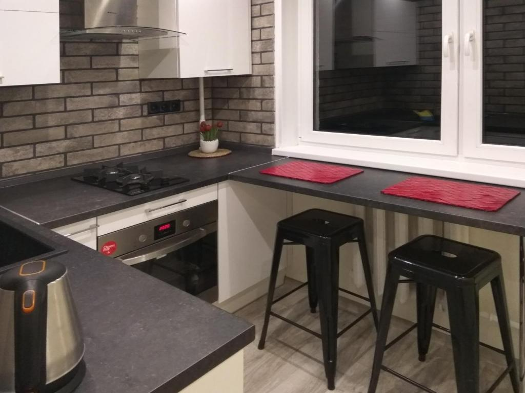 A kitchen or kitchenette at Apartment on Litovskii Val