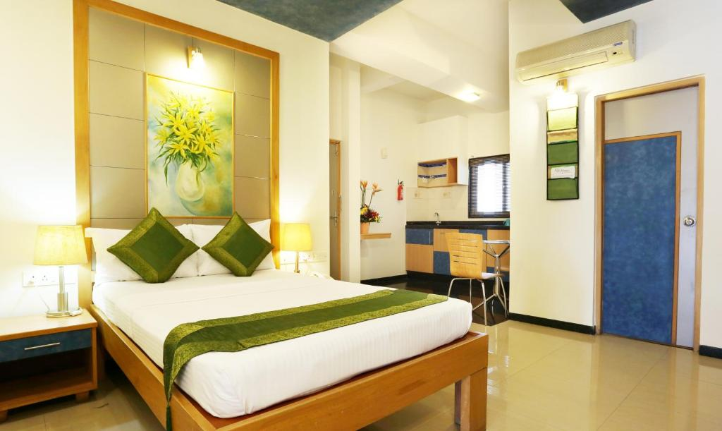 A bed or beds in a room at Treebo Trend Edha Suites