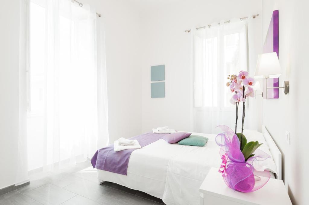 Cama o camas de una habitación en Residenza Maxima