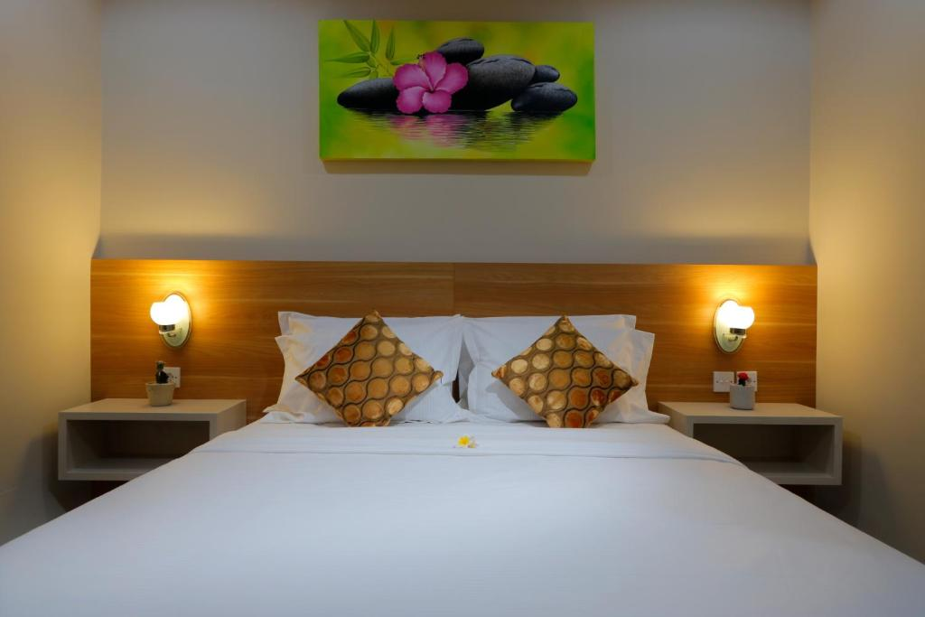 A bed or beds in a room at Iconic Bali Living