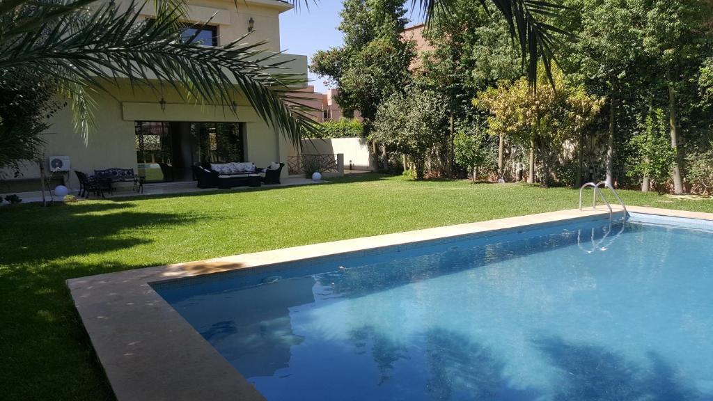 The swimming pool at or near Villa Malak Targa