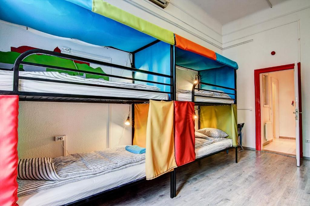 A bunk bed or bunk beds in a room at Pal's Mini Hostel