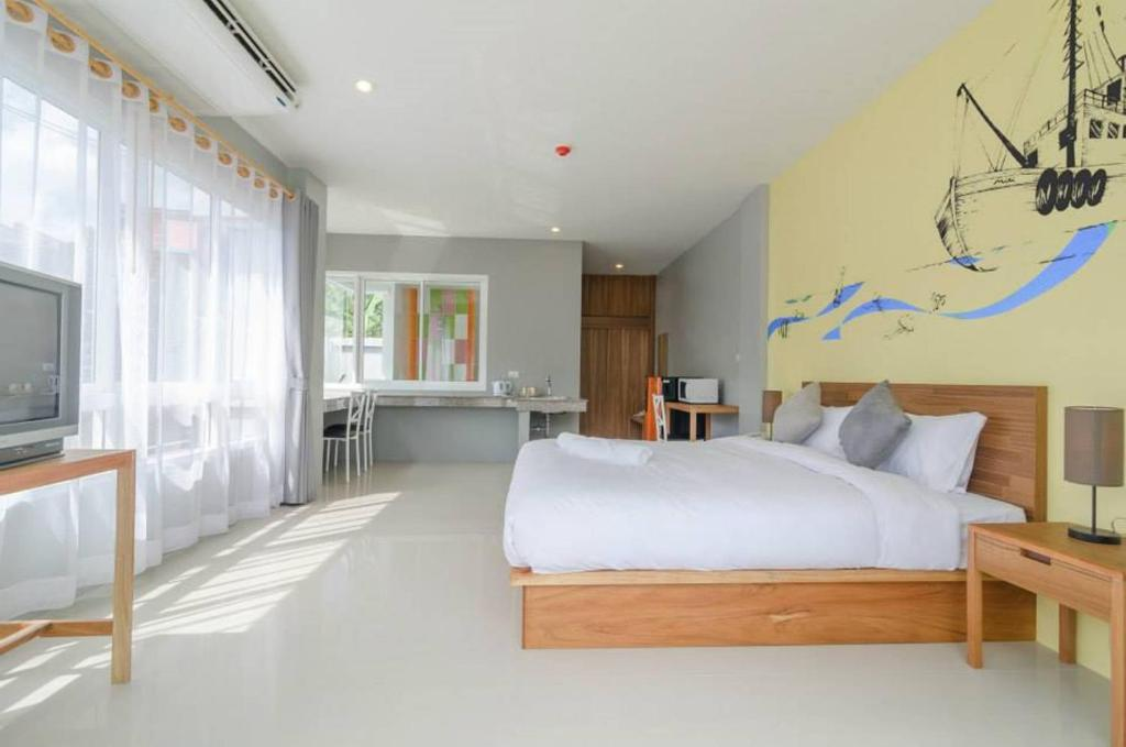 A bed or beds in a room at Ao Nang Miti Resort