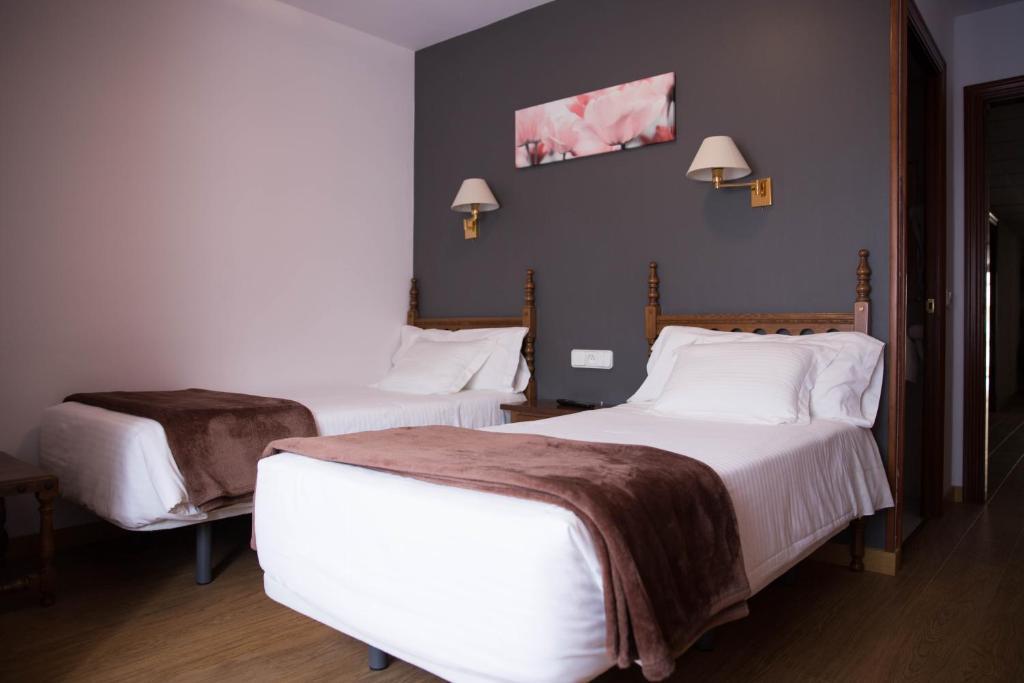 Llit o llits en una habitació de Hotel Bruna