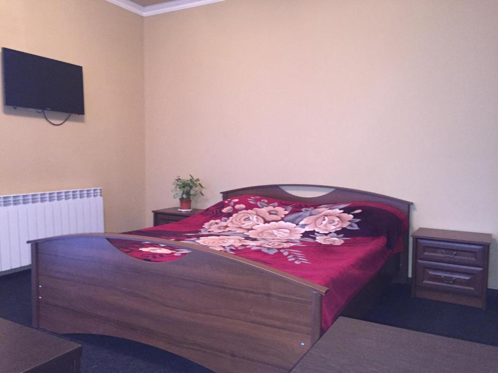 Кровать или кровати в номере Мини-отель Корона