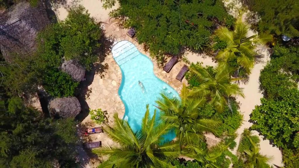 A view of the pool at Demani Lodge Zanzibar or nearby