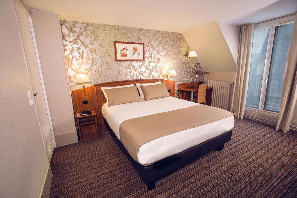 Cama o camas de una habitación en Timhotel Palais Royal