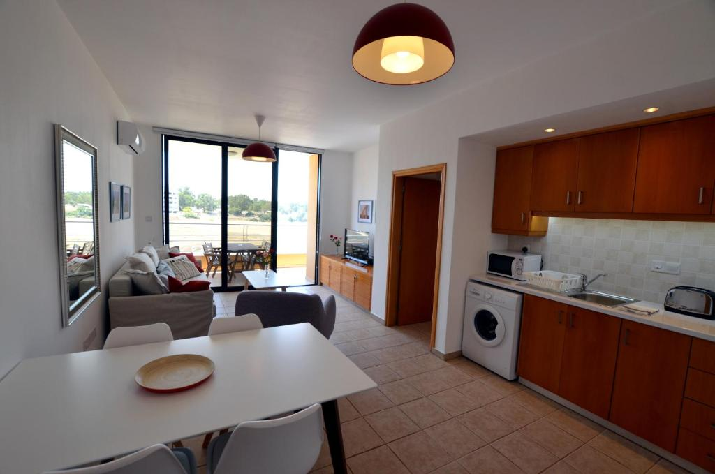 A kitchen or kitchenette at Isabella One Bedroom