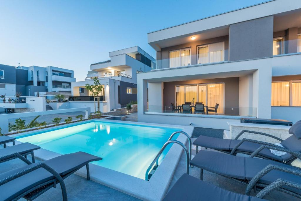 The swimming pool at or near Apartments with pool Villa Zora