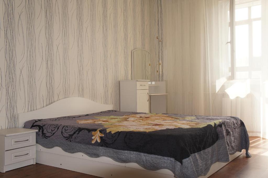 Кровать или кровати в номере Apartment in Center on Trilissera