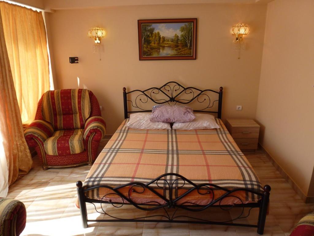 Кровать или кровати в номере Apartment on Vinogradnaya
