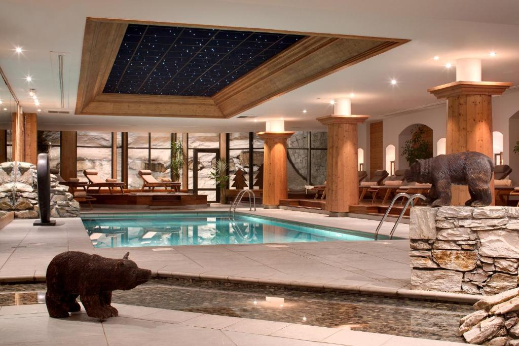 The swimming pool at or near Hôtel Les Barmes De l'Ours